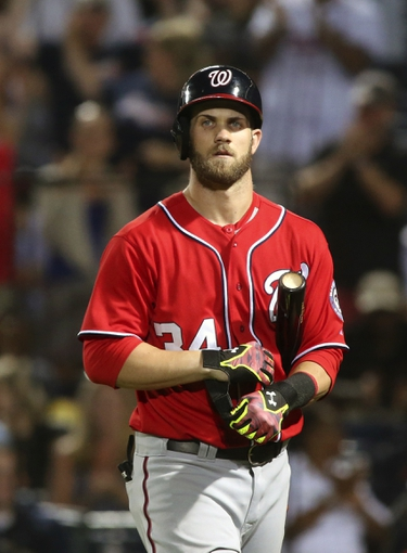 Aug 10, 2014; Atlanta, GA, USA; Washington Nationals left fielder Bryce Harper (34) reacts after striking out against Atlanta Braves relief pitcher Craig Kimbrel (not pictured) in the ninth inning of their game at Turner Field. The Braves won 3-1. Mandatory Credit: Jason Getz-USA TODAY Sports
