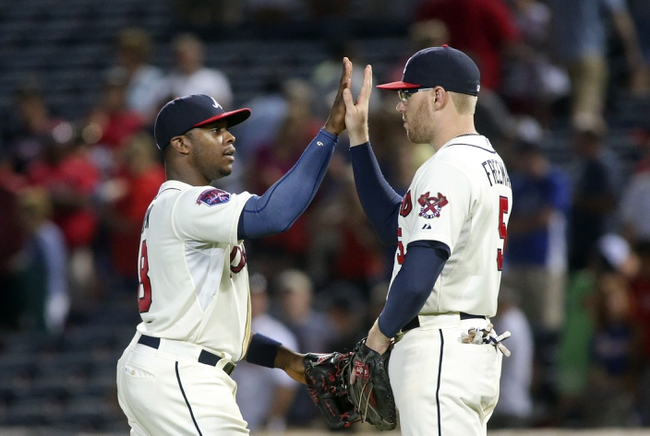 Aug 10, 2014; Atlanta, GA, USA; Atlanta Braves left fielder Justin Upton (8) and first baseman Freddie Freeman (5) celebrate after their win over the Washington Nationals at Turner Field. The Braves won 3-1. Mandatory Credit: Jason Getz-USA TODAY Sports