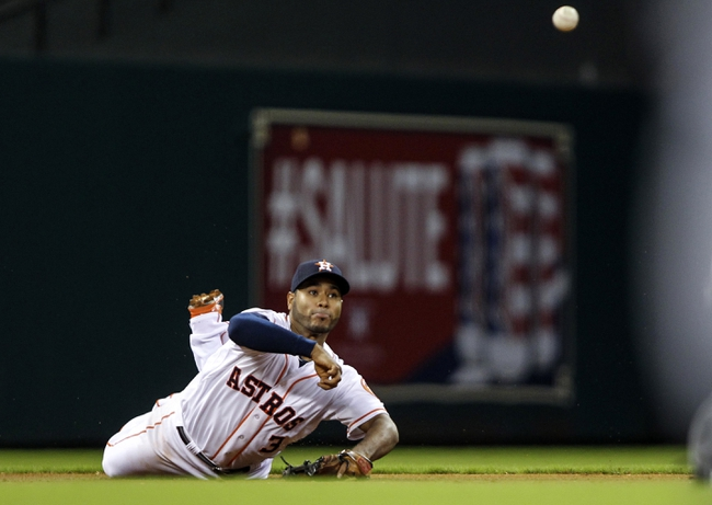 Aug 11, 2014; Houston, TX, USA; Houston Astros shortstop Gregorio Petit (3) throws to second base during the first inning against the Minnesota Twins at Minute Maid Park. Mandatory Credit: Troy Taormina-USA TODAY Sports