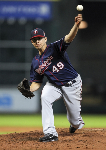 Aug 11, 2014; Houston, TX, USA; Minnesota Twins starting pitcher Tommy Milone (49) pitches during the third inning against the Houston Astros at Minute Maid Park. Mandatory Credit: Troy Taormina-USA TODAY Sports