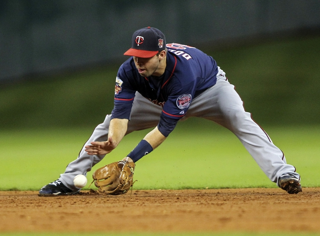 Aug 11, 2014; Houston, TX, USA; Minnesota Twins second baseman Brian Dozier (2) fields a ground ball during the third inning against the Houston Astros at Minute Maid Park. Mandatory Credit: Troy Taormina-USA TODAY Sports