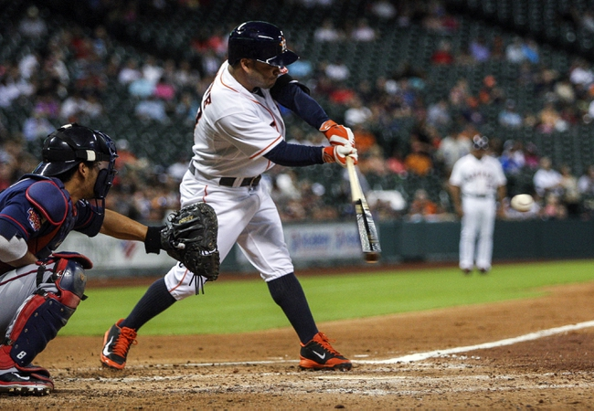 Aug 11, 2014; Houston, TX, USA; Houston Astros second baseman Jose Altuve (27) gets a single during the third inning against the Minnesota Twins at Minute Maid Park. Mandatory Credit: Troy Taormina-USA TODAY Sports
