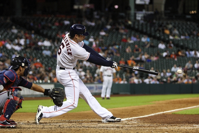 Aug 11, 2014; Houston, TX, USA; Houston Astros center fielder Jake Marisnick (6) gets a single during the fourth inning against the Minnesota Twins at Minute Maid Park. Mandatory Credit: Troy Taormina-USA TODAY Sports