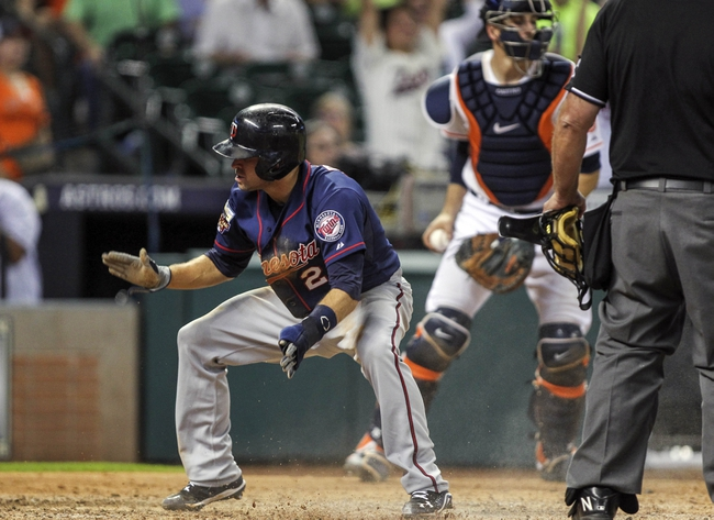 Aug 11, 2014; Houston, TX, USA; Minnesota Twins second baseman Brian Dozier (2) reacts after scoring a run during the ninth inning against the Houston Astros at Minute Maid Park. Mandatory Credit: Troy Taormina-USA TODAY Sports