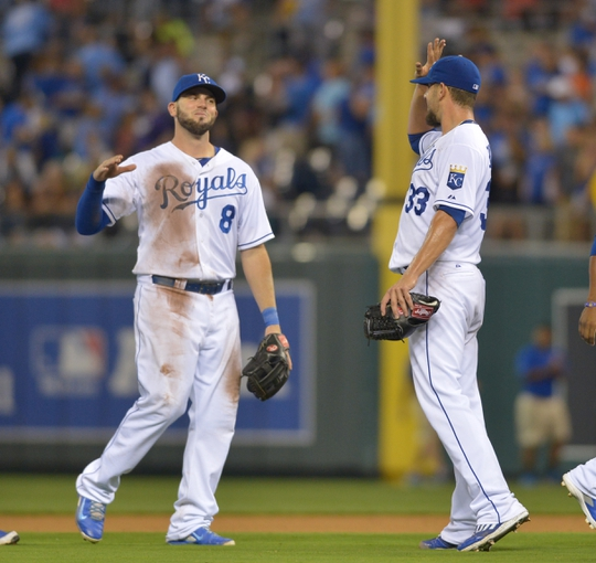 Aug 9, 2014; Kansas City, MO, USA; Kansas City Royals starting pitcher James Shields (33) is congratulated by Kansas City Royals third baseman Mike Moustakas (8) after the game against the San Francisco Giants at Kauffman Stadium. The Royals won 5-0. Mandatory Credit: Denny Medley-USA TODAY Sports