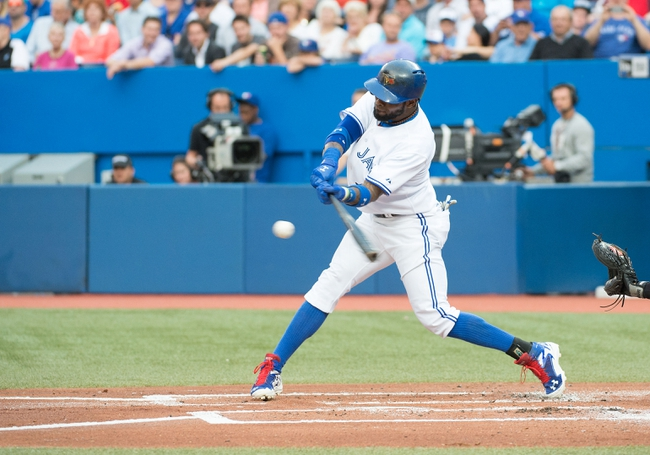 Aug 7, 2014; Toronto, Ontario, CAN; Toronto Blue Jays shortstop Jose Reyes (7) attempts to hit a ball in a game against the Baltimore Orioles at Rogers Centre. The Baltimore Orioles won 2-1. Mandatory Credit: Nick Turchiaro-USA TODAY Sports