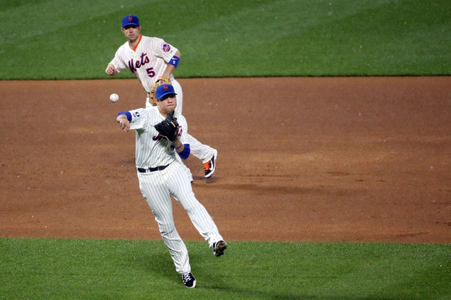 Aug 12, 2014; New York, NY, USA;  New York Mets shortstop Wilmer Flores (4) throws to first for an out on Washington Nationals second baseman Asdrubal Cabrera (not pictured) during the third inning at Citi Field. Mandatory Credit: Anthony Gruppuso-USA TODAY Sports