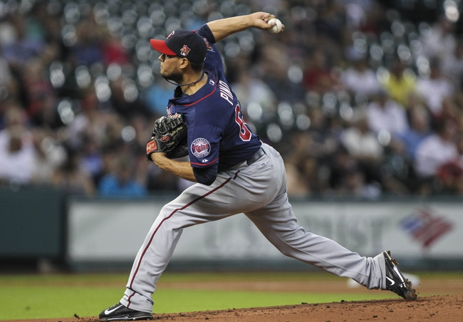 Aug 12, 2014; Houston, TX, USA; Minnesota Twins starting pitcher Yohan Pino (63) delivers a pitch during the first inning against the Houston Astros at Minute Maid Park. Mandatory Credit: Troy Taormina-USA TODAY Sports