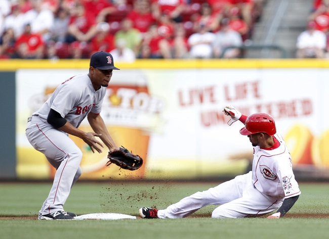Aug 12, 2014; Cincinnati, OH, USA; Cincinnati Reds center fielder Billy Hamilton (6) steals second base against Boston Red Sox shortstop Xander Bogaerts (2) during the first inning at Great American Ball Park. Mandatory Credit: Frank Victores-USA TODAY Sports