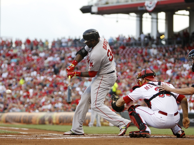 Aug 12, 2014; Cincinnati, OH, USA; Boston Red Sox designated hitter David Ortiz (34) singles during the first inning against the Cincinnati Reds at Great American Ball Park. Mandatory Credit: Frank Victores-USA TODAY Sports