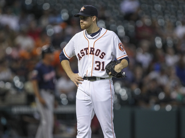 Aug 12, 2014; Houston, TX, USA; Houston Astros starting pitcher Collin McHugh (31) reacts after giving up a home run during the second inning against the Minnesota Twins at Minute Maid Park. Mandatory Credit: Troy Taormina-USA TODAY Sports