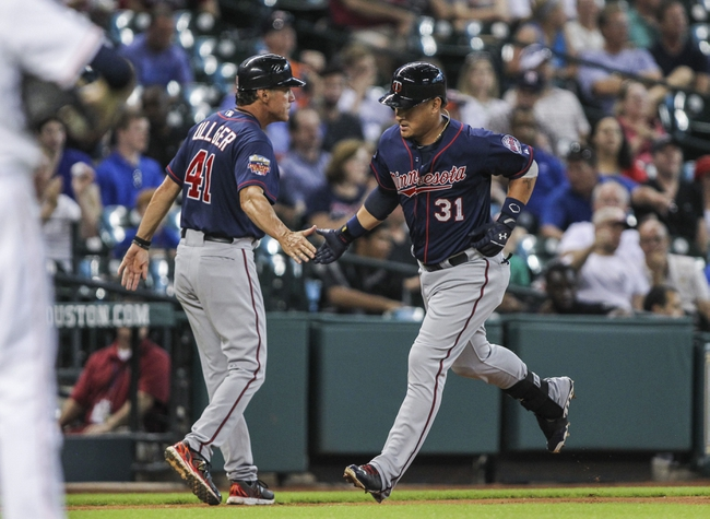 Aug 12, 2014; Houston, TX, USA; Minnesota Twins right fielder Oswaldo Arcia (31) is congratulated by third base coach Scott Ullger (41) after hitting a home run during the second inning against the Houston Astros at Minute Maid Park. Mandatory Credit: Troy Taormina-USA TODAY Sports