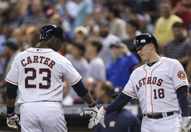 Aug 12, 2014; Houston, TX, USA; Houston Astros designated hitter Chris Carter (23) is congratulated by left fielder Marc Krauss (18) after hitting a home run during the third inning against the Minnesota Twins at Minute Maid Park. Mandatory Credit: Troy Taormina-USA TODAY Sports