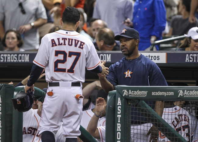 Aug 12, 2014; Houston, TX, USA; Houston Astros second baseman Jose Altuve (27) is congratulated by manager Bo Porter (16) after scoring a run during the third inning against the Minnesota Twins at Minute Maid Park. Mandatory Credit: Troy Taormina-USA TODAY Sports