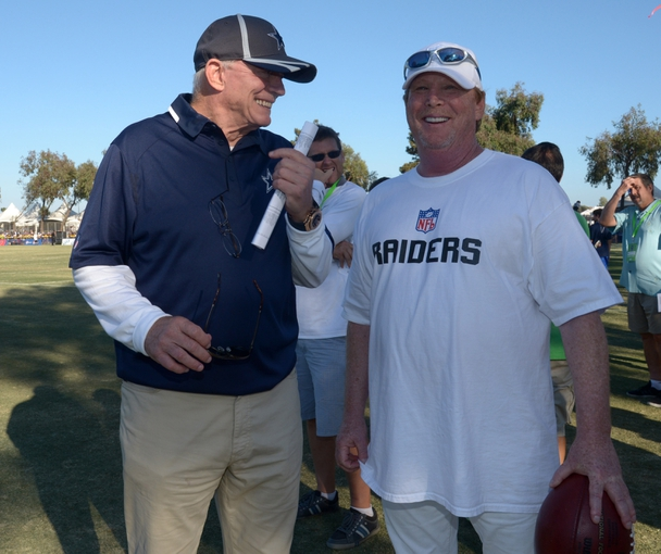 Aug 12, 2014; Oxnard, CA, USA; Dallas Cowboys owner Jerry Jones (left) and Oakland Raiders owner Mark Davis at scrimmage at River Ridge Fields. Mandatory Credit: Kirby Lee-USA TODAY Sports