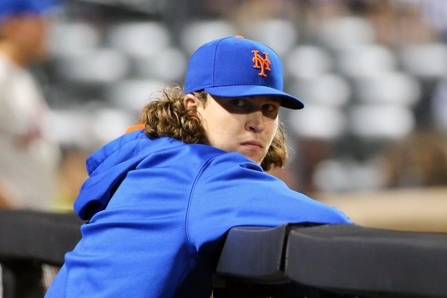 Aug 12, 2014; New York, NY, USA;  New York Mets starting pitcher Jacob deGrom (48) watches the game against the Washington Nationals from the dugout during the fourth inning at Citi Field. Mandatory Credit: Anthony Gruppuso-USA TODAY Sports