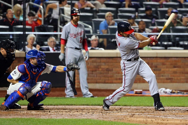 Aug 12, 2014; New York, NY, USA; Washington Nationals third baseman Anthony Rendon (6) hits a home run to left during the sixth inning New York Mets at Citi Field. Mandatory Credit: Anthony Gruppuso-USA TODAY Sports