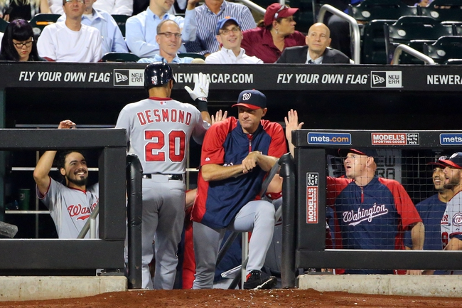 Aug 12, 2014; New York, NY, USA; Washington Nationals shortstop Ian Desmond (20) high fives into the dugout after his home run during the sixth inning against the New York Mets at Citi Field. Mandatory Credit: Anthony Gruppuso-USA TODAY Sports