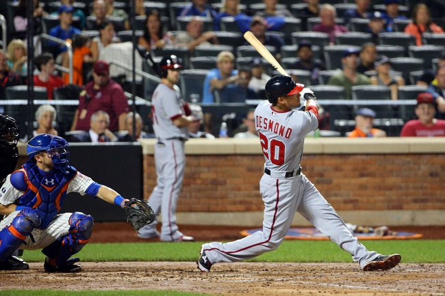 Aug 12, 2014; New York, NY, USA; Washington Nationals shortstop Ian Desmond (20) hits a two run home run during the sixth inning against the New York Mets at Citi Field. Mandatory Credit: Anthony Gruppuso-USA TODAY Sports
