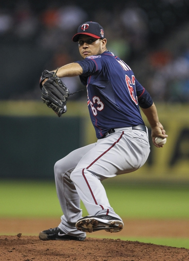 Aug 12, 2014; Houston, TX, USA; Minnesota Twins starting pitcher Yohan Pino (63) delivers a pitch during the third inning against the Houston Astros at Minute Maid Park. Mandatory Credit: Troy Taormina-USA TODAY Sports