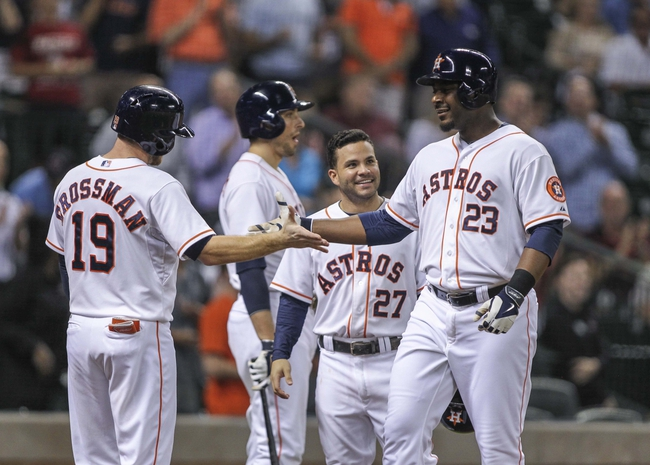 Aug 12, 2014; Houston, TX, USA; Houston Astros designated hitter Chris Carter (23) is congratulated by right fielder Robbie Grossman (19) and second baseman Jose Altuve (27) after hitting a home run during the fifth inning against the Minnesota Twins at Minute Maid Park. Mandatory Credit: Troy Taormina-USA TODAY Sports
