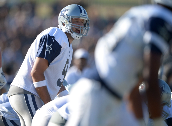 Aug 12, 2014; Oxnard, CA, USA; Dallas Cowboys quarterback Tony Romo (9) takes the snap at scrimmage against the Oakland Raiders at River Ridge Fields. Mandatory Credit: Kirby Lee-USA TODAY Sports