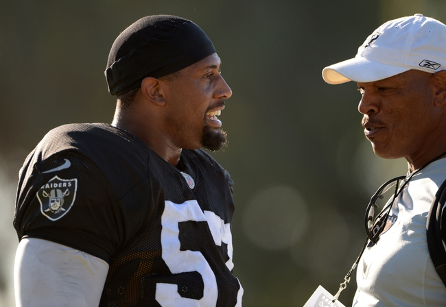 Aug 12, 2014; Oxnard, CA, USA; Oakland Raiders defensive end LaMarr Woodley (57) and Los Angeles Raiders former defensive end Greg Townsend at scrimmage against the Dallas Cowboys at River Ridge Fields. Mandatory Credit: Kirby Lee-USA TODAY Sports
