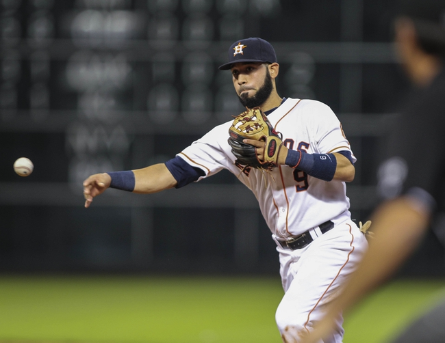 Aug 12, 2014; Houston, TX, USA; Houston Astros shortstop Marwin Gonzalez (9) throws to first base during the sixth inning against the Minnesota Twins at Minute Maid Park. Mandatory Credit: Troy Taormina-USA TODAY Sports