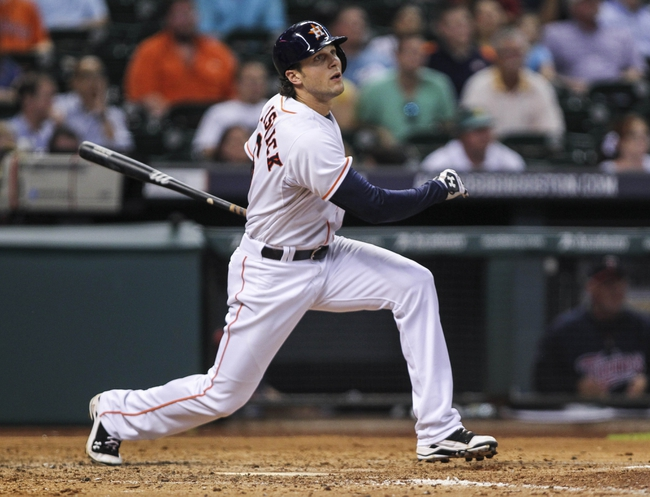 Aug 12, 2014; Houston, TX, USA; Houston Astros center fielder Jake Marisnick (6) hits a double during the sixth inning against the Minnesota Twins at Minute Maid Park. Mandatory Credit: Troy Taormina-USA TODAY Sports