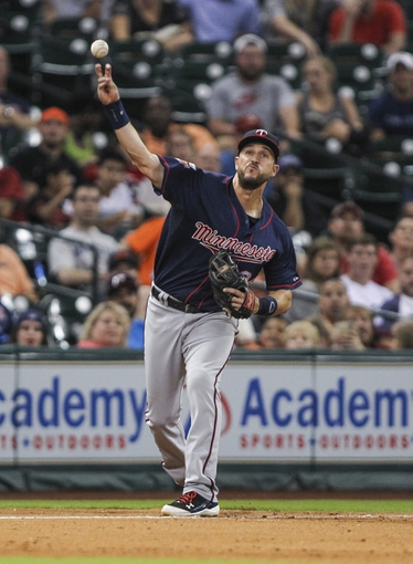 Aug 12, 2014; Houston, TX, USA; Minnesota Twins third baseman Trevor Plouffe (24) throws to first base during the sixth inning against the Houston Astros at Minute Maid Park. Mandatory Credit: Troy Taormina-USA TODAY Sports