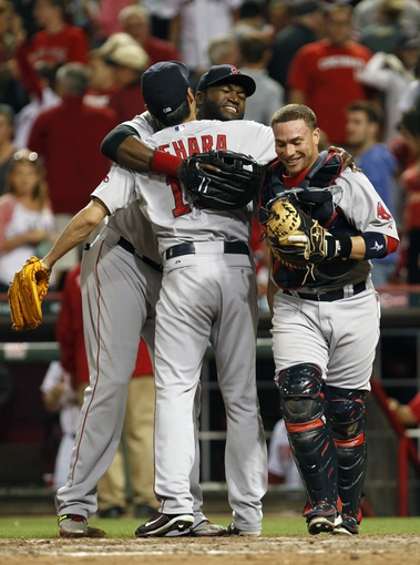 Aug 12, 2014; Cincinnati, OH, USA; Boston Red Sox relief pitcher Koji Uehara (19) celebrates at the end of the game with first baseman David Ortiz (34) and catcher Christian Vazquez (55) at Great American Ball Park. The Red Sox defeated the Reds 3-2. Mandatory Credit: Frank Victores-USA TODAY Sports