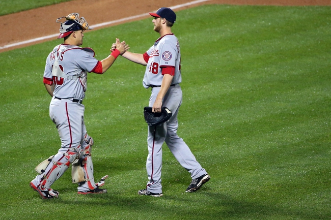 Aug 12, 2014; New York, NY, USA;  Washington Nationals catcher Wilson Ramos (40) and relief pitcher Ross Detwiler (48) celebrate the win against the New York Mets at Citi Field. Washington Nationals won 7-1.  Mandatory Credit: Anthony Gruppuso-USA TODAY Sports