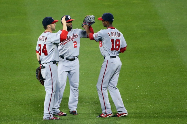 Aug 12, 2014; New York, NY, USA; Washington Nationals left fielder Bryce Harper (34), center fielder Denard Span (2) and center fielder Michael Taylor (18) celebrate the win against the New York Mets at Citi Field. Washington Nationals won 7-1.  Mandatory Credit: Anthony Gruppuso-USA TODAY Sports