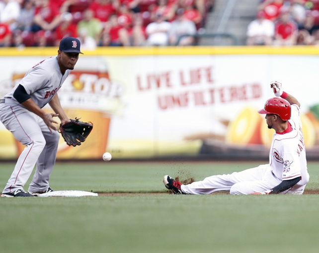Aug 12, 2014; Cincinnati, OH, USA; Cincinnati Reds center fielder Billy Hamilton (6) steals second base against Boston Red Sox shortstop Xander Bogaerts (2) during the first inning against the Boston Red Sox at Great American Ball Park. Mandatory Credit: Frank Victores-USA TODAY Sports