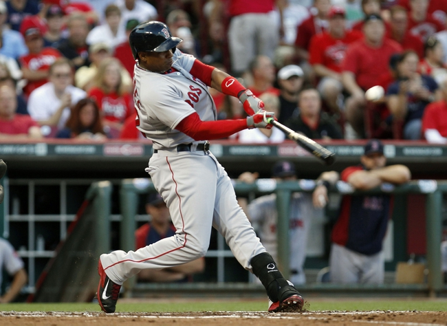 Aug 12, 2014; Cincinnati, OH, USA; Boston Red Sox left fielder Yoenis Cespedes (52) bats during the third inning against the Cincinnati Reds at Great American Ball Park. Mandatory Credit: Frank Victores-USA TODAY Sports