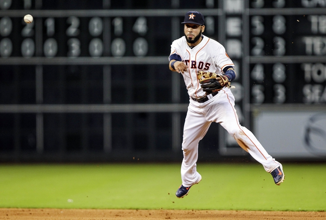 Aug 12, 2014; Houston, TX, USA; Houston Astros shortstop Marwin Gonzalez (9) throws to first base during the eighth inning against the Minnesota Twins at Minute Maid Park. Mandatory Credit: Troy Taormina-USA TODAY Sports