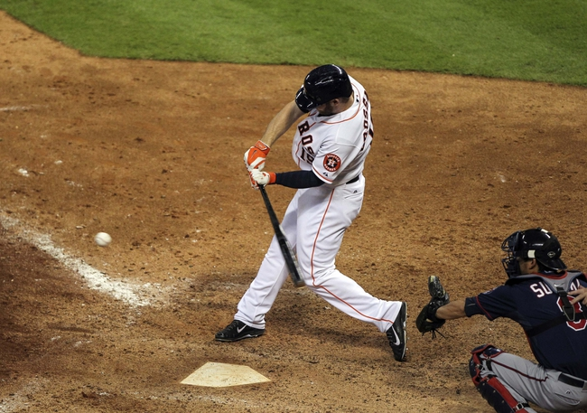 Aug 12, 2014; Houston, TX, USA; Houston Astros right fielder Robbie Grossman (19) gets a single during the eighth inning against the Minnesota Twins at Minute Maid Park. The Astros defeated the Twins 10-4. Mandatory Credit: Troy Taormina-USA TODAY Sports
