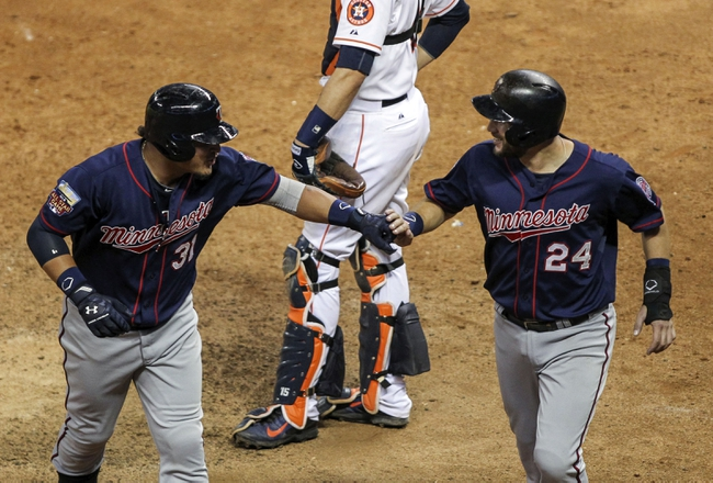 Aug 12, 2014; Houston, TX, USA; Minnesota Twins right fielder Oswaldo Arcia (31) is congratulated by third baseman Trevor Plouffe (24) after hitting a home run during the ninth inning against the Houston Astros at Minute Maid Park. The Astros defeated the Twins 10-4. Mandatory Credit: Troy Taormina-USA TODAY Sports