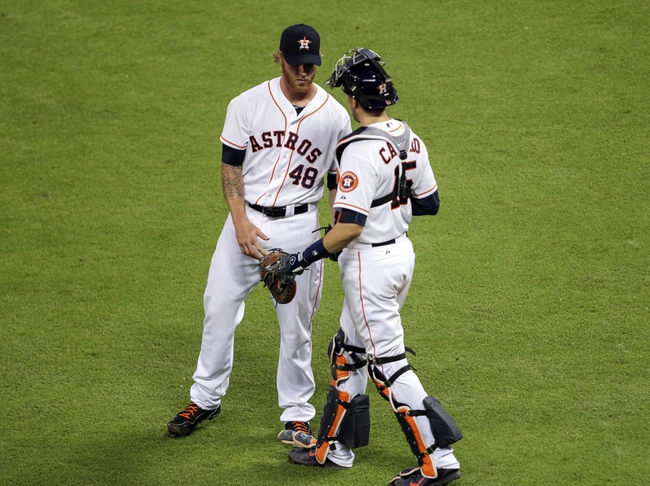Aug 12, 2014; Houston, TX, USA; Houston Astros relief pitcher Mike Foltynewicz (48) is congratulated by catcher Jason Castro (15) after defeating the Minnesota Twins 10-4 at Minute Maid Park. Mandatory Credit: Troy Taormina-USA TODAY Sports