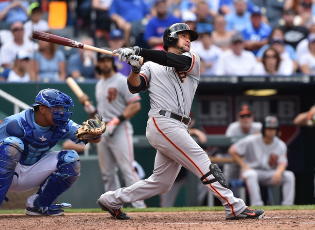 Aug 10, 2014; Kansas City, MO, USA; San Francisco Giants left fielder Gregor Blanco (7) at bat against the Kansas City Royals during the fifth inning at Kauffman Stadium. Mandatory Credit: Peter G. Aiken-USA TODAY Sports