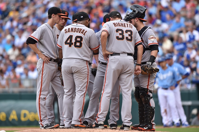Aug 10, 2014; Kansas City, MO, USA; San Francisco Giants pitching coach Dave Righetti (33) talks with pitcher Tim Lincecum and the entire infield against the Kansas City Royals during the second inning at Kauffman Stadium. Mandatory Credit: Peter G. Aiken-USA TODAY Sports
