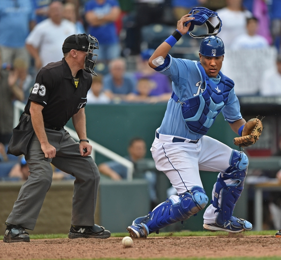Aug 10, 2014; Kansas City, MO, USA; Kansas City Royals catcher Salvador Perez (13) reacts after a pitch in the dirt against the San Francisco Giants during the ninth inning at Kauffman Stadium. Mandatory Credit: Peter G. Aiken-USA TODAY Sports