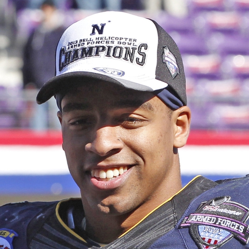 Dec 30, 2013; Fort Worth, TX, USA; Navy Midshipmen quarterback Keenan Reynolds (19) holds the MVP trophy after the game against the Middle Tennessee Blue Raiders  at Amon G. Carter Stadium.  Navy beat Middle Tennessee 24-6. Mandatory Credit: Tim Heitman-USA TODAY Sports