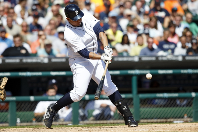 Aug 14, 2014; Detroit, MI, USA; Detroit Tigers first baseman Miguel Cabrera (24) hits a double in the eighth inning against the Pittsburgh Pirates at Comerica Park. Mandatory Credit: Rick Osentoski-USA TODAY Sports