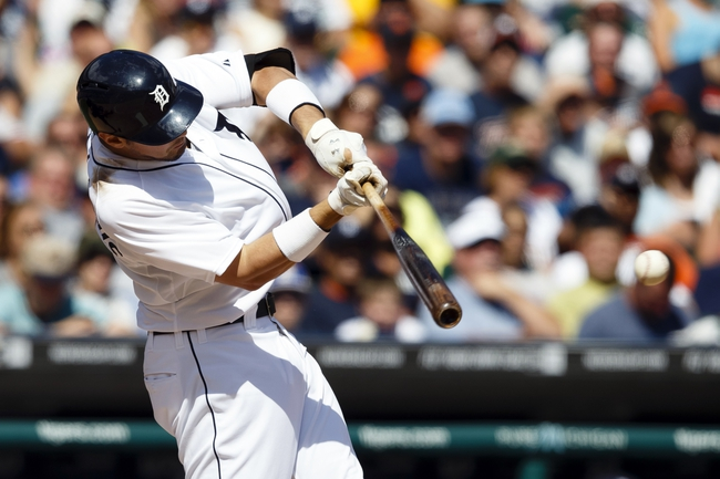Aug 14, 2014; Detroit, MI, USA; Detroit Tigers third baseman Nick Castellanos (9) hits a two RBI single in the eighth inning against the Pittsburgh Pirates at Comerica Park. Mandatory Credit: Rick Osentoski-USA TODAY Sports