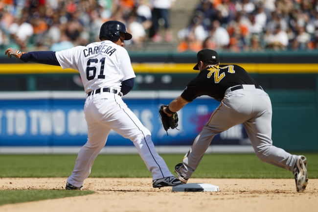 Aug 14, 2014; Detroit, MI, USA; Detroit Tigers left fielder Ezequiel Carrera (61) is safe on a steal of second ahead of the tag by Pittsburgh Pirates infielder Jayson Nix (27) in the eighth inning at Comerica Park. Mandatory Credit: Rick Osentoski-USA TODAY Sports