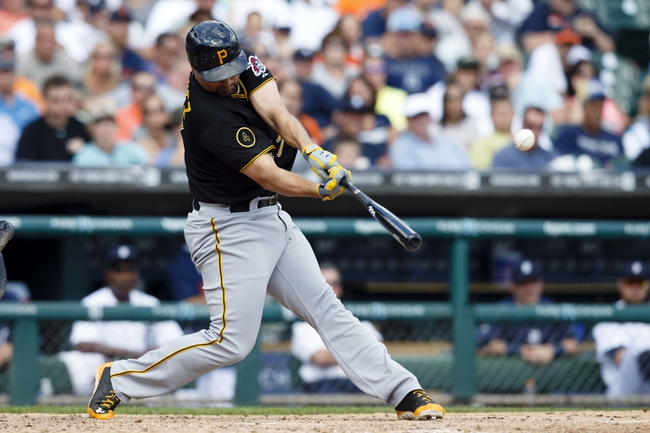 Aug 14, 2014; Detroit, MI, USA; Pittsburgh Pirates pitch hitter Gaby Sanchez (17) hits a two run home run in the ninth inning against the Detroit Tigers at Comerica Park. Detroit won 5-2. Mandatory Credit: Rick Osentoski-USA TODAY Sports