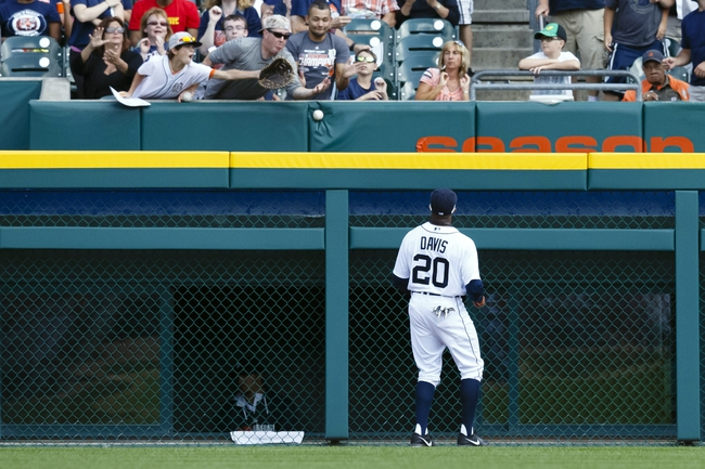 Aug 14, 2014; Detroit, MI, USA; Detroit Tigers left fielder Rajai Davis (20) watches as a ball hit by Pittsburgh Pirates pinch hitter Gaby Sanchez (not pictured) goes over the left field wall for a two run home run in the ninth inning at Comerica Park. Detroit won 5-2. Mandatory Credit: Rick Osentoski-USA TODAY Sports