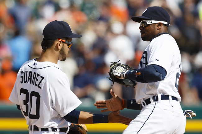 Aug 14, 2014; Detroit, MI, USA; Detroit Tigers shortstop Eugenio Suarez (30) and left fielder Rajai Davis (20) celebrate after the game against the Pittsburgh Pirates at Comerica Park. Detroit won 5-2. Mandatory Credit: Rick Osentoski-USA TODAY Sports