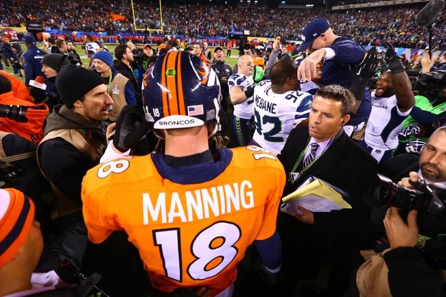 Feb 2, 2014; East Rutherford, NJ, USA; Denver Broncos quarterback Peyton Manning (18) following the game against the Seattle Seahawks in Super Bowl XLVIII at MetLife Stadium.  Mandatory Credit: Mark J. Rebilas-USA TODAY Sports